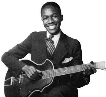 Josh White with his acoustic guitar, 1935